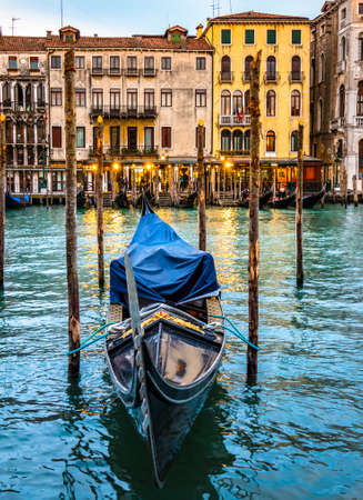 typical famous gondolas in venice - italy 写真素材