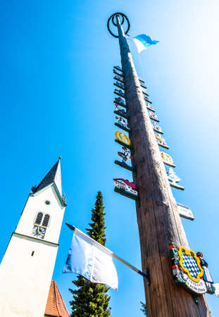 Sindelsdorf - Germany, May 21: typical bavarian maypole with paintings in front of blue sky in sindelsdorf, bavaria/germany on May 21, 2018 Editorial