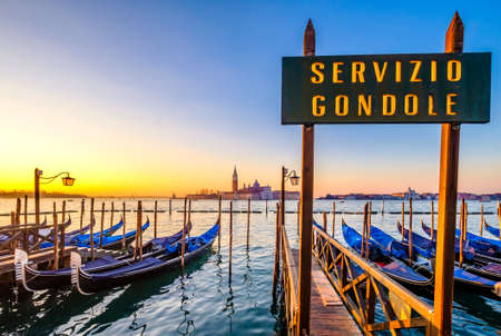 typical famous gondolas in venice - italy - translation: gondola service