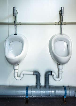 unusual urinals at a public restroom