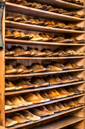 old shoe lasts at a shoemaker