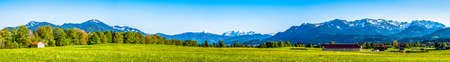panorama of the european alps near benediktbeuern - bavaria - view from wackersberg near bad toelz