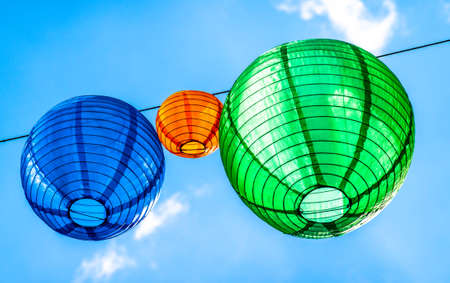 lanterns in front of blue sky - space for text