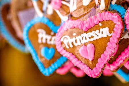 typical souvenir at the oktoberfest in munich - a gingerbread heart - lebkuchenherz - translation: princess