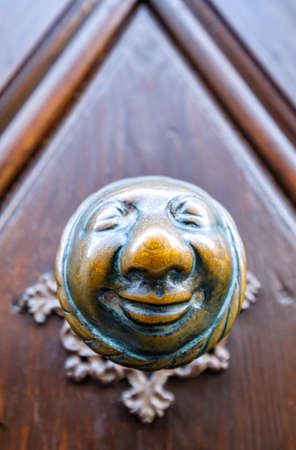 famous historic door handle in bamberg - called apfelweibla