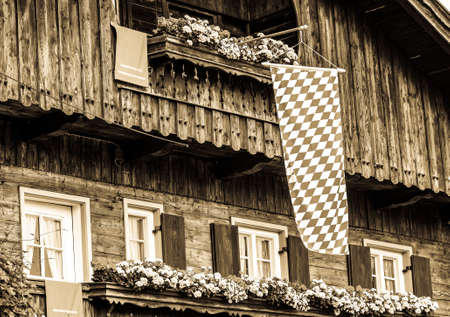 typical bavarian flag in front of a house