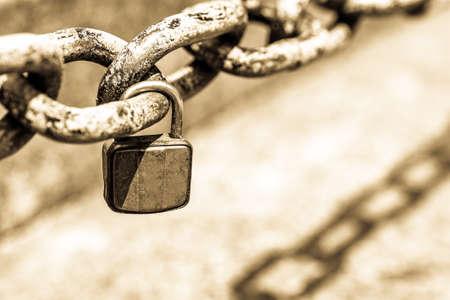 old padlock at a chain Stock Photo