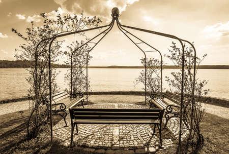 old park bench at a lake Stock Photo