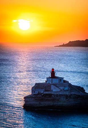 famous lighthouse at the coast of corsica - bonifacio