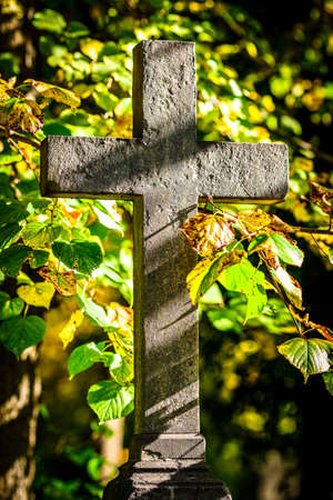 old cross at a cemetery