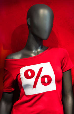 mannequin with sale shirt - photo