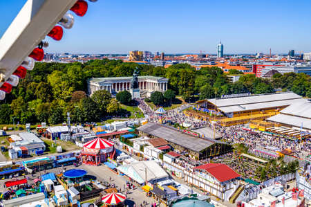munich, Germany - September 21: the oktoberfest - carousels and people at the world greatest annual fair on september 21, 2019 in munich Standard-Bild - 140142257