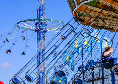 munich, Germany - September 24: the oktoberfest - chain carousel and people at the world greatest annual fair on september 24, 2019 in munich Standard-Bild - 140142259