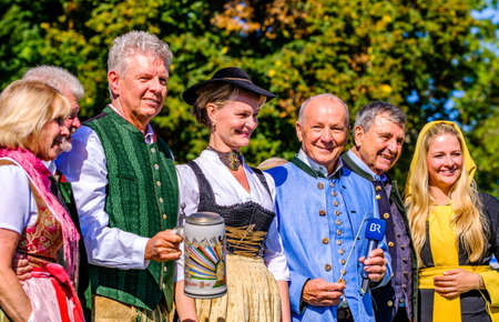 Munich, Germany - September 29: participants and musicians at the traditional open-air concert on the oktoberfest in munich at September 29, 2019 Standard-Bild - 140142374