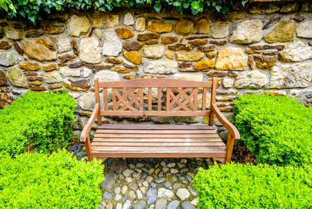 typical wooden parkbench at a patio Stockfoto