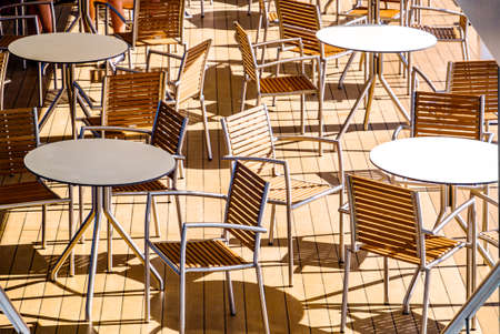 table and chairs at a cafe in vienna