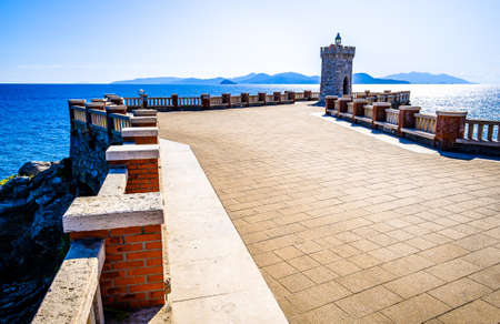 famous lighthouse at the harbor of piombino in italy Stock Photo