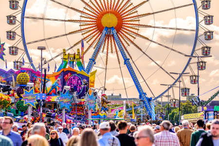 munich, Germany - September 24: the oktoberfest - carousels and people at the world greatest annual fair on september 24, 2019 in munich Standard-Bild - 140142876