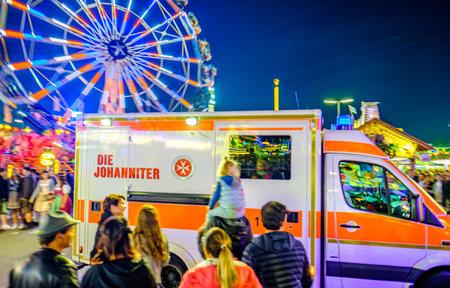 Munich, Germany - September 28: Car of the Medical Service (Ambulance) on the Oktoberfest in Munich on September 28, 2019 Standard-Bild - 140142878