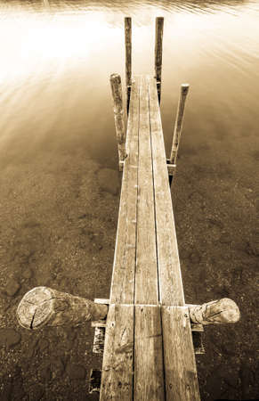 old wooden jetty at a lake - bavaria