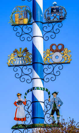Miesbach, Germany - April 12: typical bavarian maypole with old paintings at the old town of Miesbach on April 12, 2020