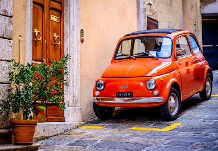 Verona, Italy - August 21: famous old fiat 500 cinquencento at the old town of verona on August 21, 2014 Redakční
