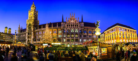 Munich, Germany - December 3: famous christmas market with sales booths and visitors on the marienplatz in Munich on December 3, 2019