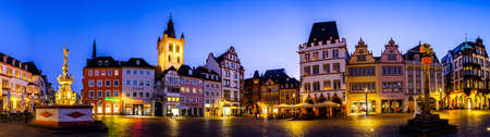Trier, Germany - July 6: historic buildings and tourists at the famous old town of Trier in Germany on July 6, 2020