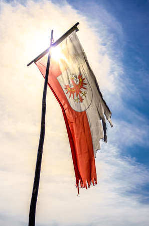 tyrol flag in front of sky - photo