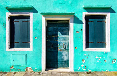 old window at a facade - photo