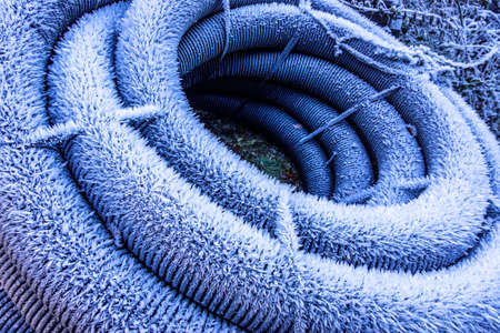 frosted tube at a construction site in winter