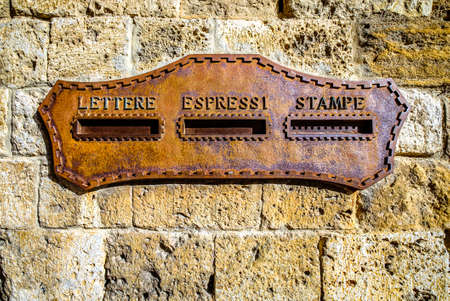 old letterbox at a door in italy - translation: letterbox, express, printed matter Stockfoto