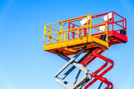 modern lifter in front blue sky - cherry picker Standard-Bild
