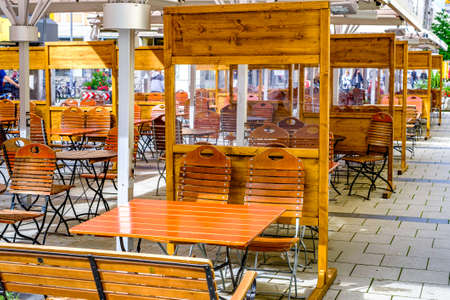 tables with separation at a beergarden in munich