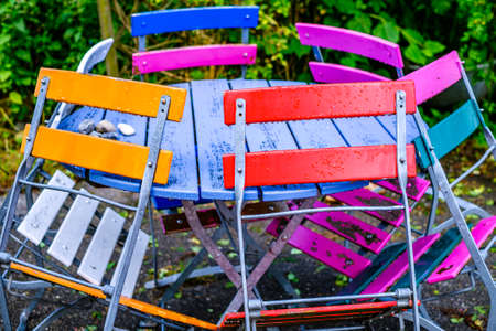 colorful folding chairs at a beergarden - photo