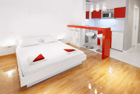modern bedroom: Modern bedroom with kitchenette en-suite