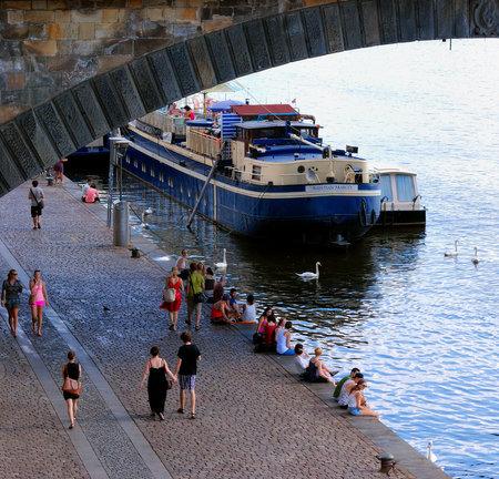 embankment: An Unidentified People on Prague Embankment