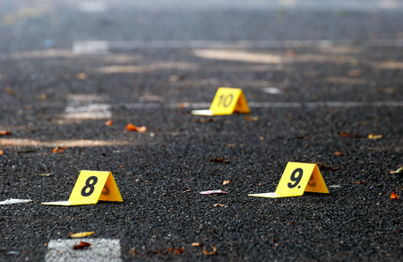 fingerprinting: Crime Evidence Marker on Asphalt