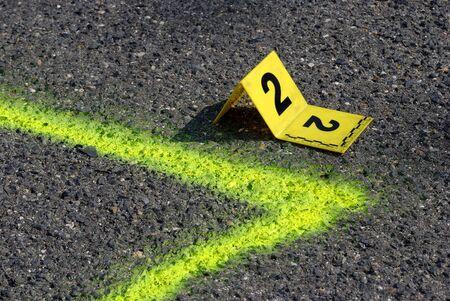 fingerprinting: Crime Evidence Marker on Asphalt