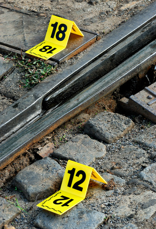 fingerprinting: Crime Scene Evidence Markers Near Rails Stock Photo