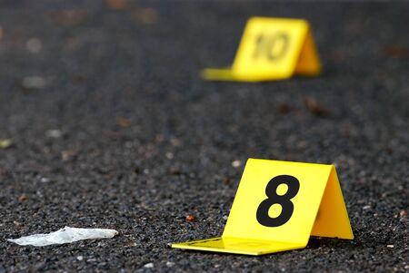 fingerprinting: Crime Evidence Markers on Asphalt