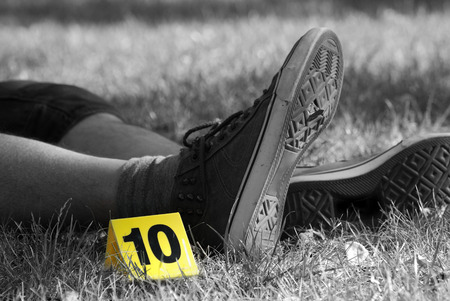 fingerprinting: Crime Scene Evidence Marker Next to Legs Stock Photo