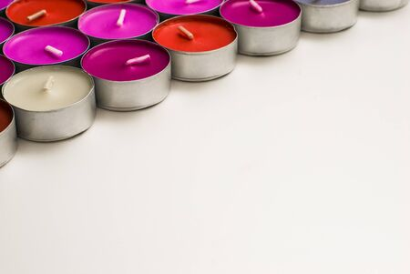 tea candles: Tea Candles Colored Background Stock Photo