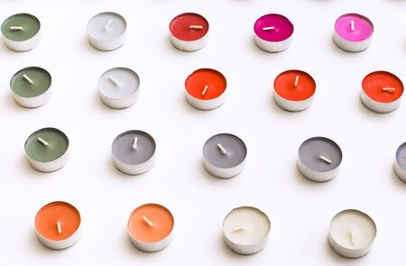tea candles: Tea Candles Arranged to Rows on White Background Desk Stock Photo