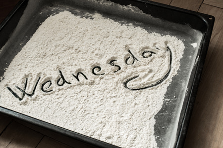 wednesday: Wednesday Word Written on Baking Sheet Covered with White Flour