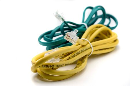 tied together: Yellow and Green Network Cables Tied Together