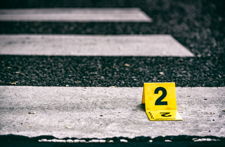 Crime scene marker on the asphalt