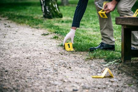 Crime scene investigation, placing the crime scene marker on the ground