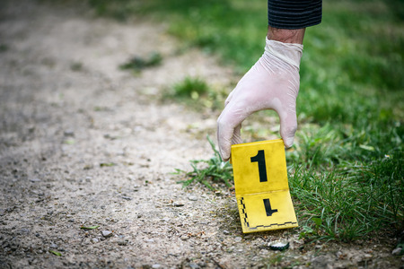 Crime scene investigation, placing the crime scene marker on the ground