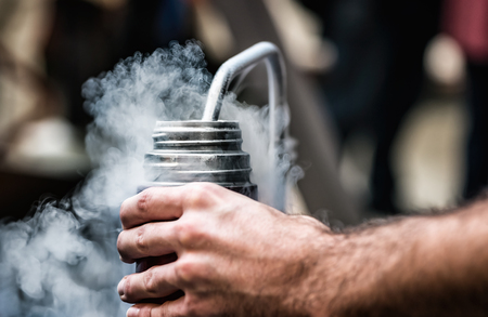 Filling the bottle with liquid nitrogen